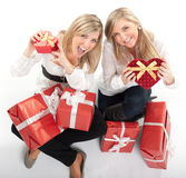 Happy girls with presents Stock Images