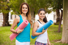 Happy girls ready for some yoga Royalty Free Stock Image