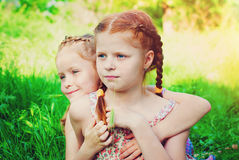 Happy Girls with Red Hair outdoors in Summer. Beautiful Happy Girls with Red Hair outdoors in Summer. Healthy Children. Family Concept - Sisters Love Stock Image