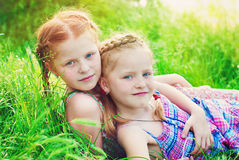 Happy Girls with Red Hair outdoors in Summer. Beautiful Happy Girls with Red Hair outdoors in Summer. Healthy Children. Family Concept - Sisters Love Royalty Free Stock Photos