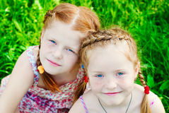 Happy Girls with Red Hair outdoors in Summer. Beautiful Happy Girls with Red Hair outdoors in Summer. Healthy Children. Family Concept - Sisters Love Stock Photography