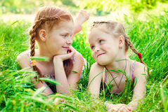 Happy Girls with Red Hair outdoors in Summer. Beautiful Happy Girls with Red Hair outdoors in Summer. Healthy Children. Family Concept - Sisters Love Royalty Free Stock Photography