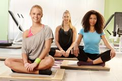 Happy girls resting at the gym Stock Images