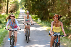 Happy girls riding bicycles outside Royalty Free Stock Images
