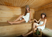 Happy girls  in sauna Stock Photos