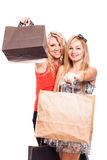 Happy girls with shopping bags Stock Images