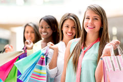 Happy girls shopping Stock Images
