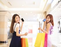Girls showing phone and shopping in the mall. Happy girls showing phone and shopping in the mall Stock Photos