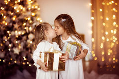 Happy girls sister friends dress white  gold  background with Ch Stock Photo