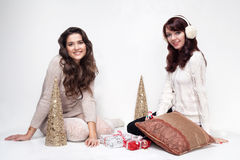 Happy girls sitting in christmas house on white background Stock Photos