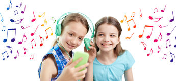 Happy girls with smartphone and headphones Royalty Free Stock Image