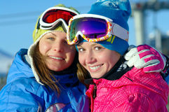 Happy girls snowboarders. Two happy girls snowboarders smiling Stock Image