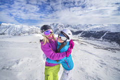 Happy girls on a snowy mountain ski resort Stock Image