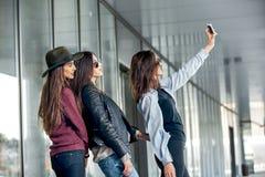 Happy girls taking a Selfie. Stock Photos