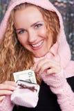 Happy girls with ten dollars Royalty Free Stock Photos