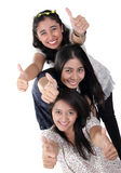3 happy girls thumbs up stock image