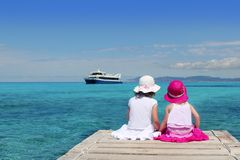 Happy girls turquoise sea in Formentera Royalty Free Stock Image