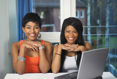 Happy girls viewing online service. Two girls with happy expression on browsing a favorite online service Stock Photos