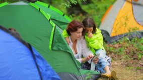 Happy Girls Watching Photos On Smartphone In Tent stock video
