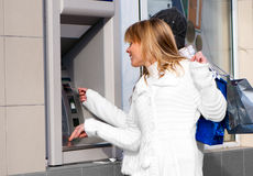 Happy girls withdrawing money Stock Images