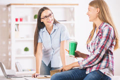 Happy girls working in office Royalty Free Stock Images