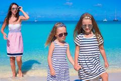 Happy girls and young mom during beach vacation Stock Images