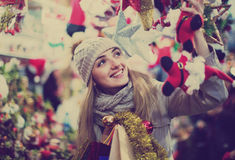 Happy glad cheerful girl choosing Christmas decoration Stock Photos