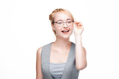 Happy and glad girl isolated on white background. Happy and glad woman in glasses satisfied with life, isolated on white background. Optimistic smiling girl Stock Photos