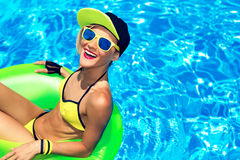Happy Glamour girl with inflatable circle in pool party Summer Royalty Free Stock Photo