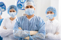 Happy glancing team of doctors royalty free stock photo