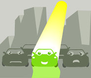 Happy go green. A happy green car among grey cars in a polluted city Royalty Free Stock Images
