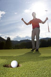 Happy golf player. Royalty Free Stock Photo