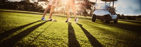 Happy golf player couple giving high five royalty free stock photography