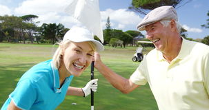 Happy golf players laughing together stock video footage