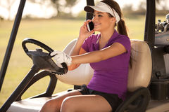 Happy golfer talking on the phone Stock Photos