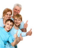 Happy good grandparents with grandchildren fooled. On a light background Stock Image