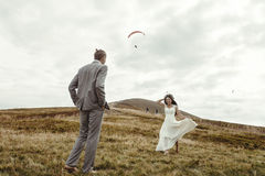 Happy gorgeous bride running to groom and having fun, luxury cer Stock Photo