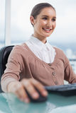 Happy gorgeous businesswoman working on her computer Royalty Free Stock Image