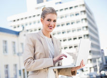 Happy gorgeous businesswoman working on laptop Stock Photography