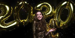 Free Happy Gorgeous Girl In Stylish Sexy Party Dress Holding Gold 2020 Balloons, Having Fun At New Year`s Eve Party Royalty Free Stock Images - 161662269