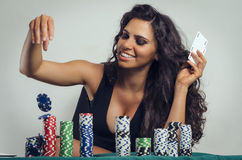 Happy gorgeous girl playing poker, throwing chips Royalty Free Stock Photography