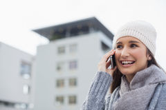 Happy gorgeous woman wearing winter clothes having a phone call Stock Image