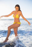 Happy gorgeous woman in yellow bikini having fun in the sea Royalty Free Stock Photos