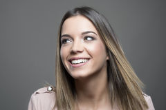 Happy gorgeous young woman looking away with white toothy smile Royalty Free Stock Image
