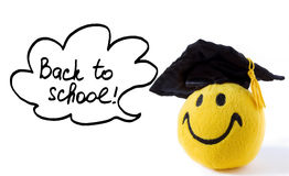 Happy grad toy saying: Back to school royalty free stock photo