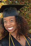 Happy graduate. Has honors and is smiling royalty free stock photography
