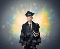 Happy graduate with colorful bokeg lights in the background Royalty Free Stock Photos