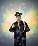 Happy graduate with colorful bokeg lights in the background Stock Photography