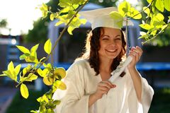 Happy graduate with diploma. Young graduate woman happy with diploma Royalty Free Stock Images