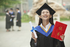 Happy Graduate with Diploma Stock Images